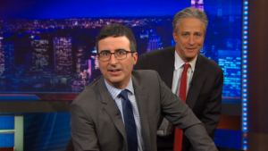 John Oliver with the man he has succeeded as Most Trusted Man on Television, Jon Stewart